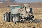 manure spreader in field