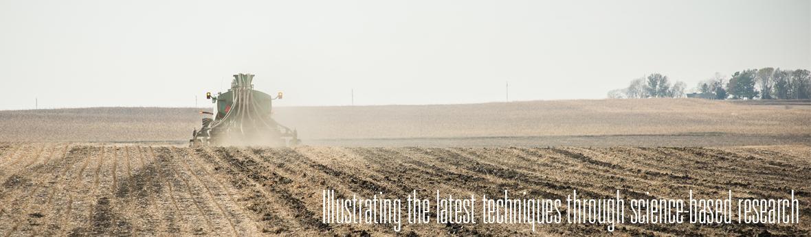 manure spreader applying manure in field