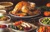 Holiday meal with turkey, and bowls of vegetables