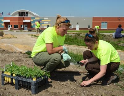 Students planting vegetation at Mitchellville Women's Correctional Facility.