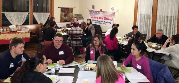 Participants in Storm Lake work in teams as part of a Leading Communities exercise.