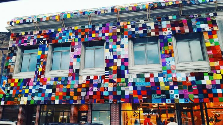 colorful photo of yarn bombing project in Ames, Iowa