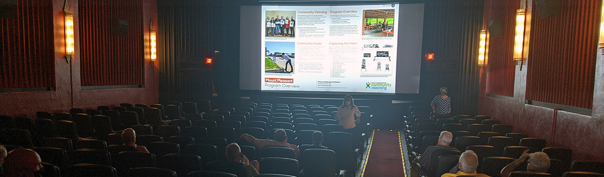 The design team in Mount Pleasant displays concept plans on the screen at the local movie theater to a socially-distanced audience.