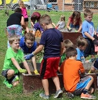 Students work on Waukon school gardens.