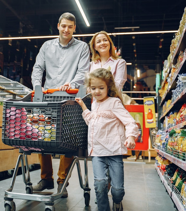 Family grocery shopping with cart.