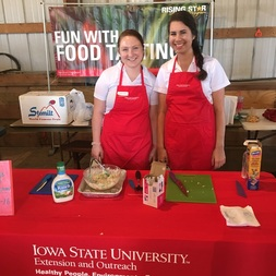 Christel and Carissa serving up Crunch Cabbage Salad