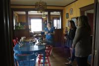 Annie showing the interns the apothecary