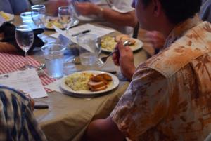 guest enjoying local foods dinner