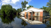 Substantially damaged house due to flooding