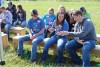High School Students sitting on a bench at Ag Exploration Day