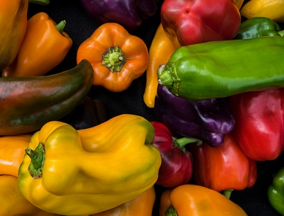 Assorted colors, sizes and varieties of peppers.