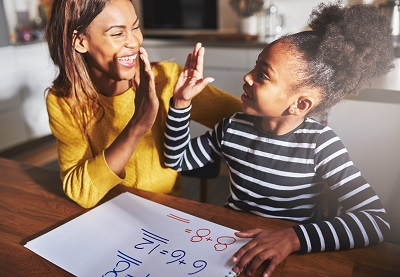 mother and daughter celebrate math homework success by Flamingo-Images/stock.adobe.com.