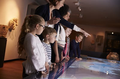 Pupils On School Field Trip To Museum Looking At Map by Monkey Business/stock.adobe.com.