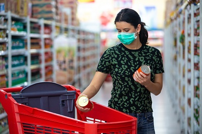 woman wearing mask shops for groceries by Space_Cat/stock.adobe.com