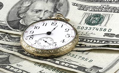 Time and Money concept image with watch and cash by justasc/stock.adobe.com.