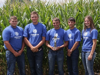 Clayton County Team One members standing in front of cornfield.