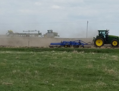 two tractors doing spring field work.