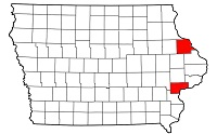 map of Iowa with Dubuque and Muscatine counties in red.