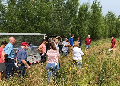 people standing in pollinator habitat.
