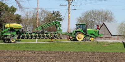 Farm equipment on the road.