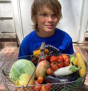 Sawyer Greiner with garden produce.