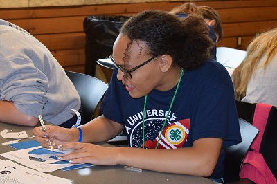 youth participates in an educational workshop at 2019 Iowa 4-H Youth Conference.