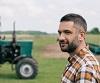 Farmer standing near tractor in field by LIGHTFIELD STUDIOS/stock.adobe.com.