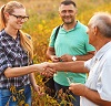 handshake between farmers in soybean field by PointImages/stock.adobe.com.