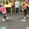 two girls playing hopscotch.