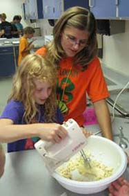 two 4H kids mixing dough