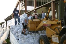 volunteers sandbagging