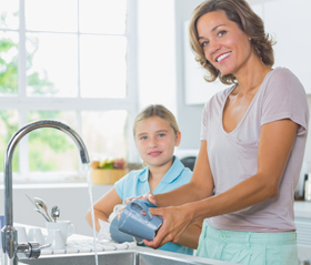 mother and child washing dishes