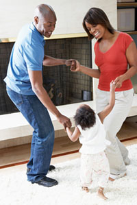 parents dancing with child