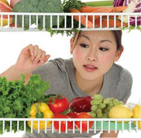 woman selecting fruits and vegetables