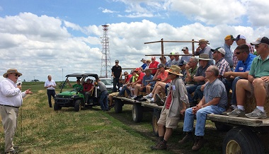 field day presenter and participants on hayrack