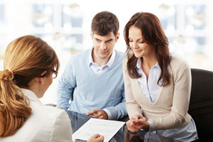 young couple consults with financial adviser