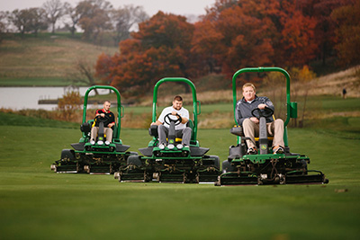 3 men mowing turf with riding lawnmowers