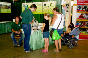 4-H'ers guide fair visitors through a biochar experiment