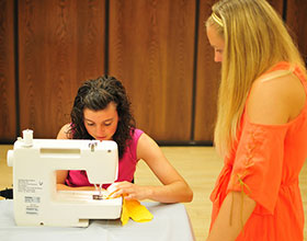 4-H'er uses sewing machine