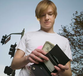 teen with wallet