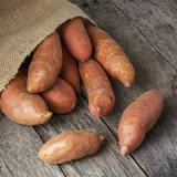 sweet potatoes in burlap sack