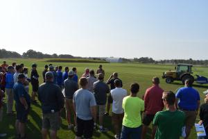 Mr. Ben Pease, Turfgrass Research Associate, discusses sports turf research projects to attendees of the 2017 Field Day.