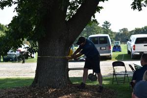 Not all was turfgrass at the recent turfgrass field day; Jay Goughnour measures an ash tree to demonstrate how to treat for E.A.