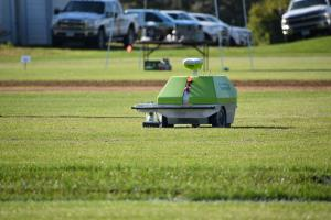 Robotic painters demonstrated how to use GPS to paint an athletic field.