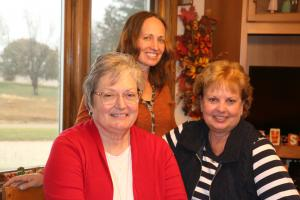 Elaine Utesch of Triple U Ranch in Woodbury County (right) with Mary Tuttle, ISU Extension and Outreach (left), and Elaine's daughter, Jessica (back).