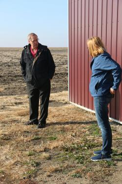 ISU Extension and Outreach farm management specialist Kelvin Leibold talks with Wright County farmer, Laurie Johnson.
