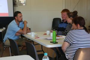 George Leishman, a Rural Financial Counseling advisor, visiting with participants at the workshop.