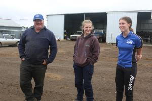 Bryan Dickson and two of their daughters on their farm in Victoria, Australia.