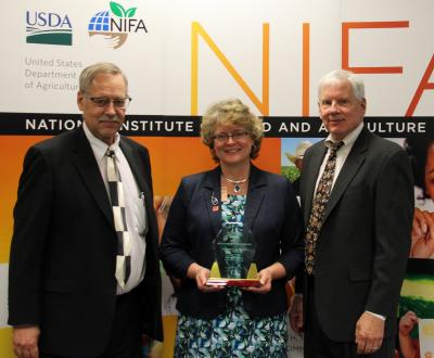 Kelvin Leibold and Madeline Schultz accept the The USDA National Institute of Food and Agriculture (NIFA) Partnership Award for Innovative Programs and Projects on April 24, 2019 in Washington, D.C.