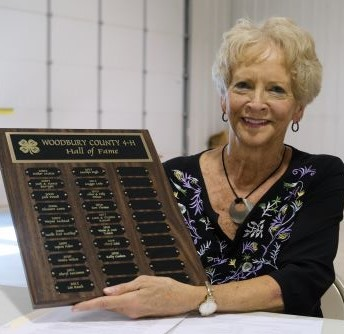 Kathy Goodwin holding plaque